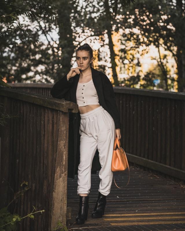 a fashion women with a handbag